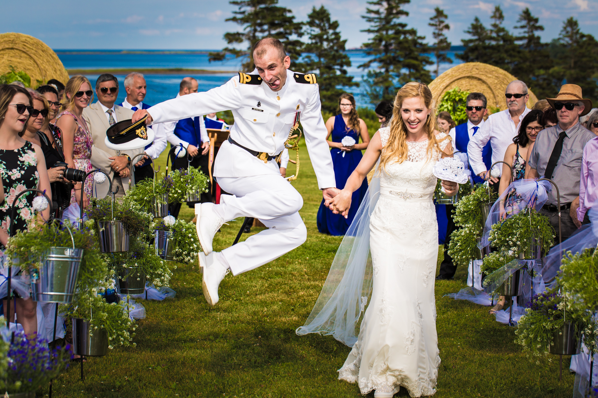 happy couple jumping for joy at prince edward island wedding
