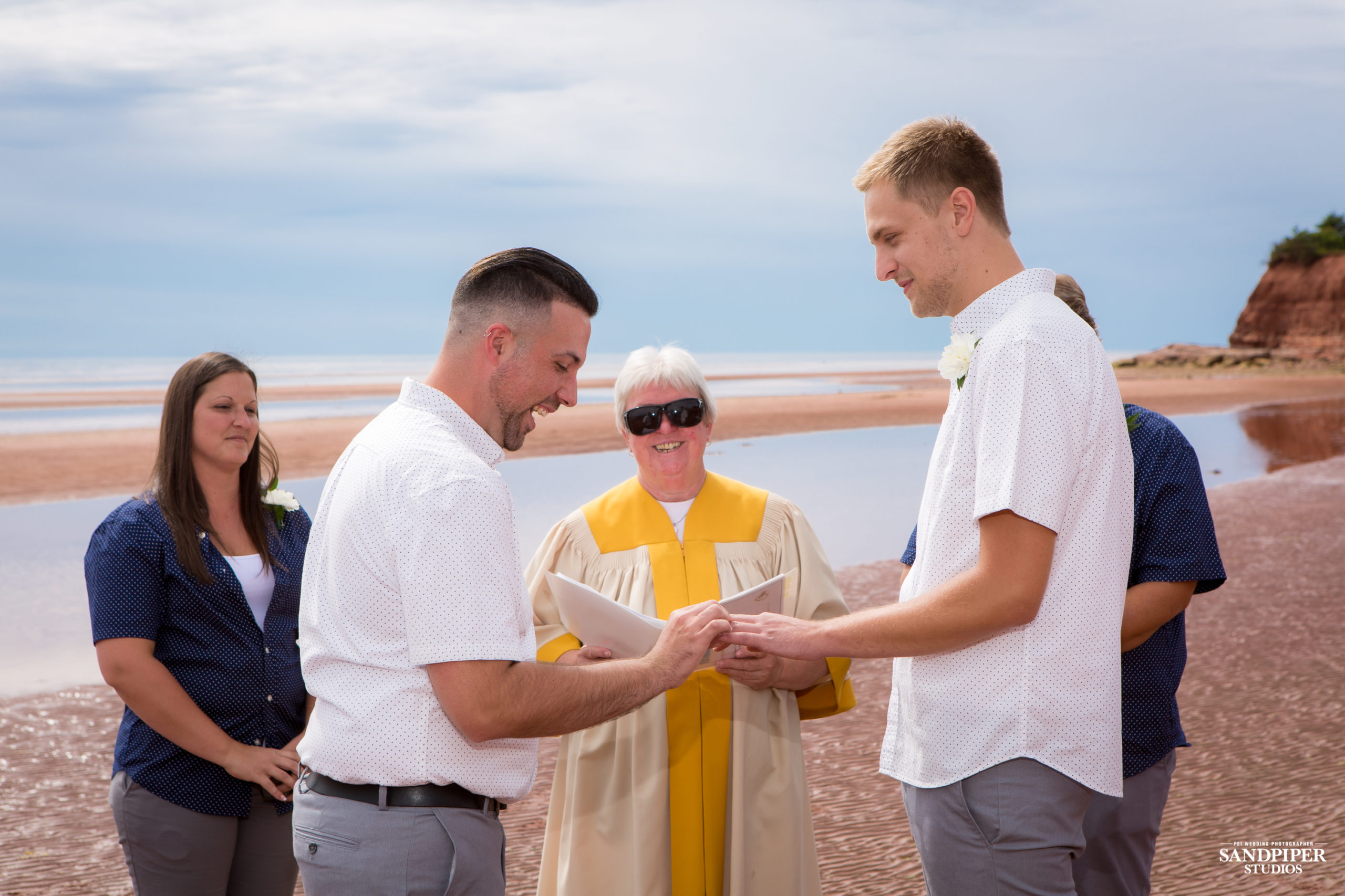 grooms exchanging rings by pei photographer